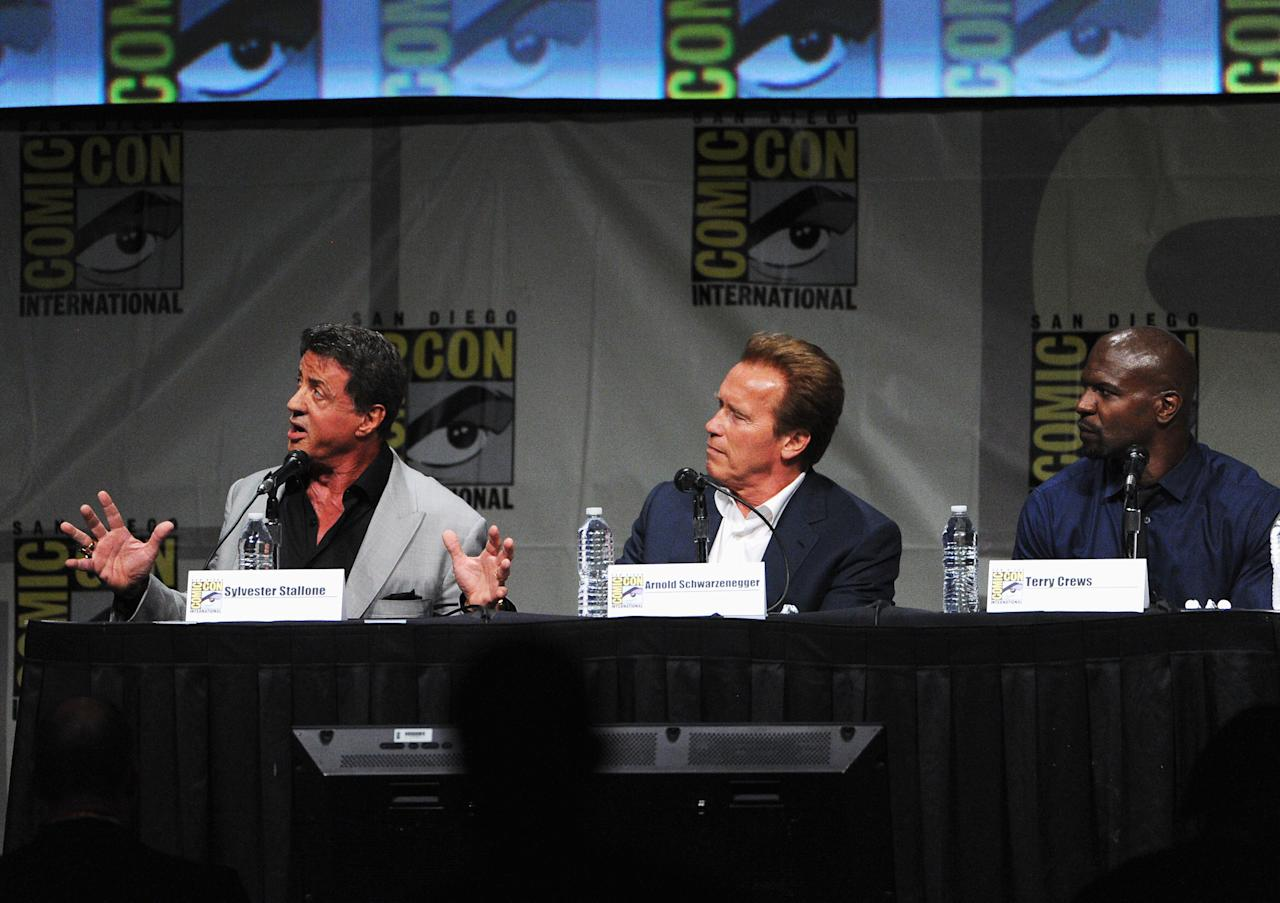"""SAN DIEGO, CA - JULY 12:  (L-R) Actors Sylvester Stallone, Dolph Lundgren, and Terry Crews  speak at """"The Expendables 2 Real American Heroes"""" Panel during Comic-Con International 2012 at San Diego Convention Center on July 12, 2012 in San Diego, California.  (Photo by Kevin Winter/Getty Images)"""
