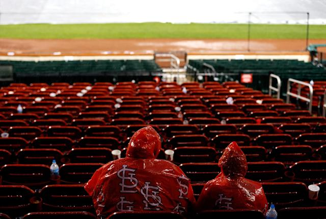 ST LOUIS, MO - OCTOBER 17: Two St. Louis Cardinals fans sit in their seats during a rain delay in the seventh inning in Game Three of the National League Championship Series between the Cardinals and the San Francisco Giants at Busch Stadium on October 17, 2012 in St Louis, Missouri. (Photo by Kevin C. Cox/Getty Images)