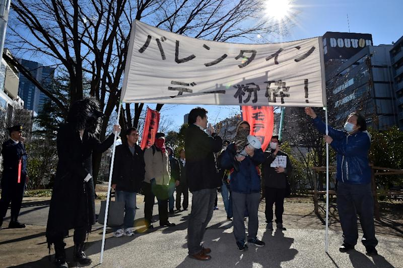 A group of Japanese gather to stage an anti-Valentine's Day demonstration march in Tokyo, on February 12, 2017