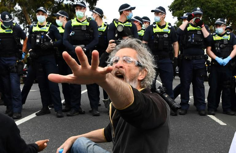 Officers used pepper spray and made over 200 arrests in Melbourne as several hundred attendees flouted stay-at-home orders and marched through an inner-city suburb (AFP/William WEST)