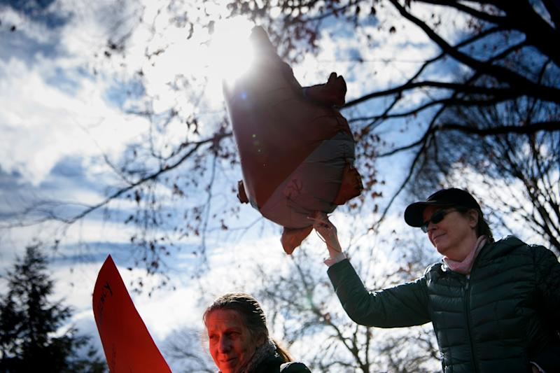 Activists rally for a President's Day protest against US President Donald Trump in Lafayette Square near the White House Feb. 18, 2019 in Washington, DC. (Photo: Brendan Smialowski/AFP/Getty Images)