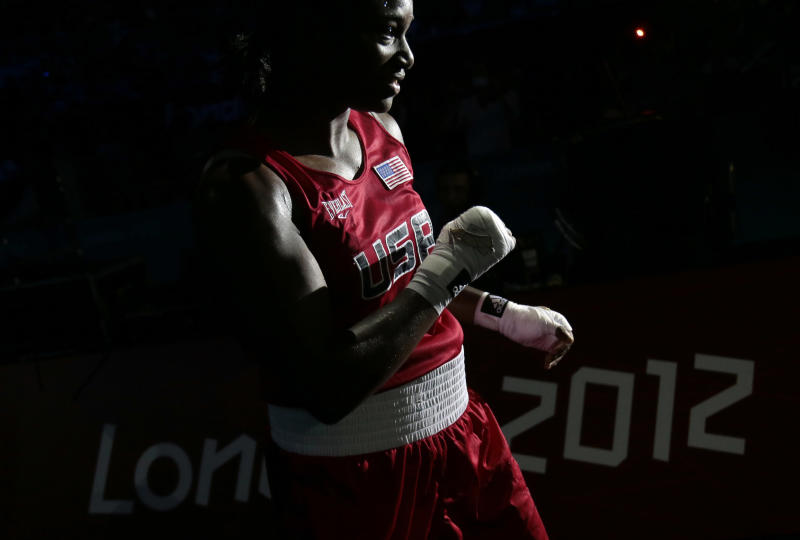 The United States' Claressa Shields, celebrates winnning against Russia's Nadezda Torlopova, in their women's middleweight 75-kg boxing gold medal match at the 2012 Summer Olympics, Thursday, Aug. 9, 2012, in London. (AP Photo/Ivan Sekretarev)