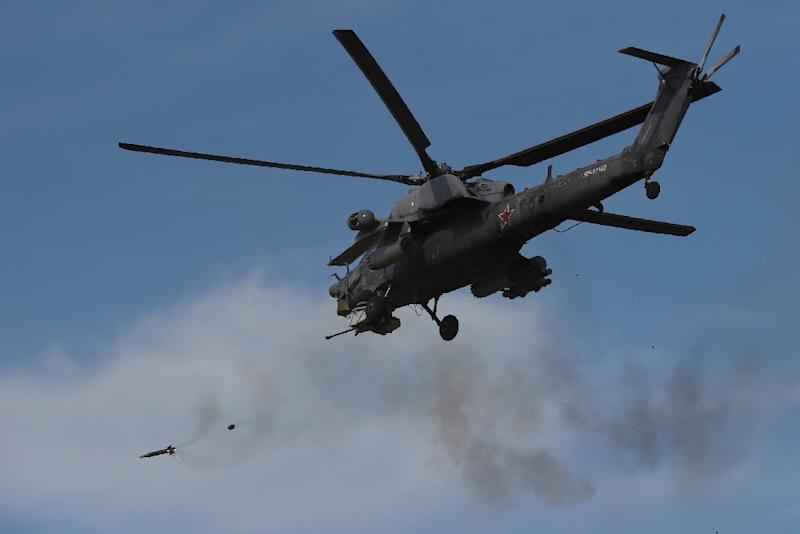 A Russian military helicopter takes part in an exercise on the Black Sea coast in Crimea