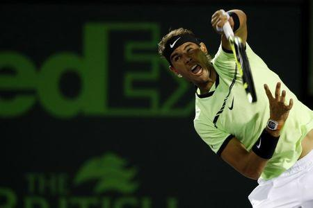 Mar 29, 2017; Miami, FL, USA; Rafael Nadal of Spain serves against Jack Sock of the United States (not pictured) on day nine of the 2017 Miami Open at Crandon Park Tennis Center. Nadal won 6-2, 6-3. Mandatory Credit: Geoff Burke-USA TODAY Sports