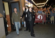 """Singer-songwriter Bruce Springsteen, left, and wife Patti Scialfa Springsteen exit out the stage door after the """"Springsteen On Broadway"""" reopening night performance at the St. James Theatre on Saturday, June 26, 2021, in New York. (Photo by Evan Agostini/Invision/AP)"""