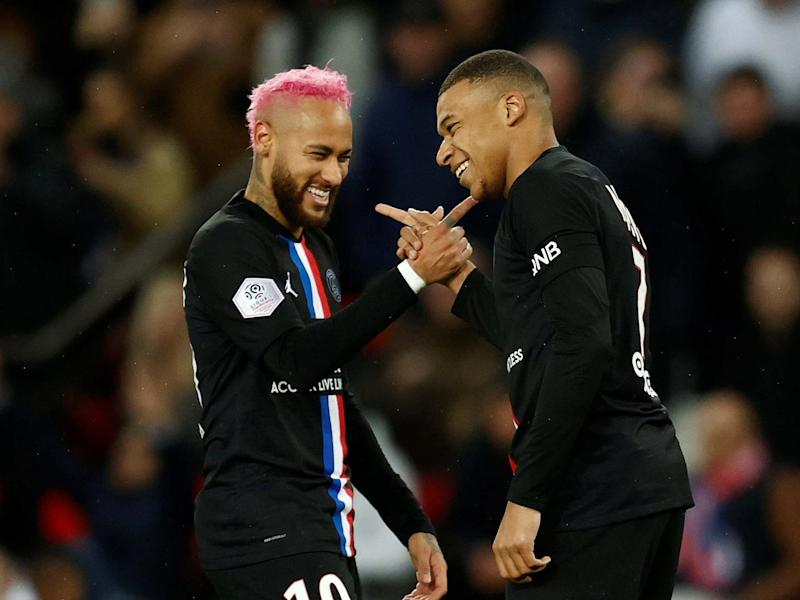 PSG's Kylian Mbappe celebrates scoring their fourth goal with Neymar: REUTERS