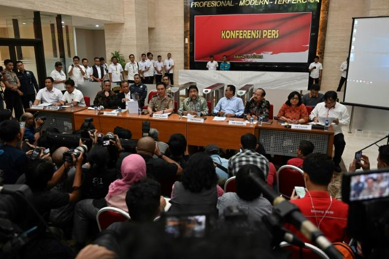 Members of the police and a multi-party fact-finding team attended a press conference to deliver the results of an investigation into an attack two years ago on Novel Baswedan, a member of the official Corruption Eradication Commission (AFP Photo/BAY ISMOYO)