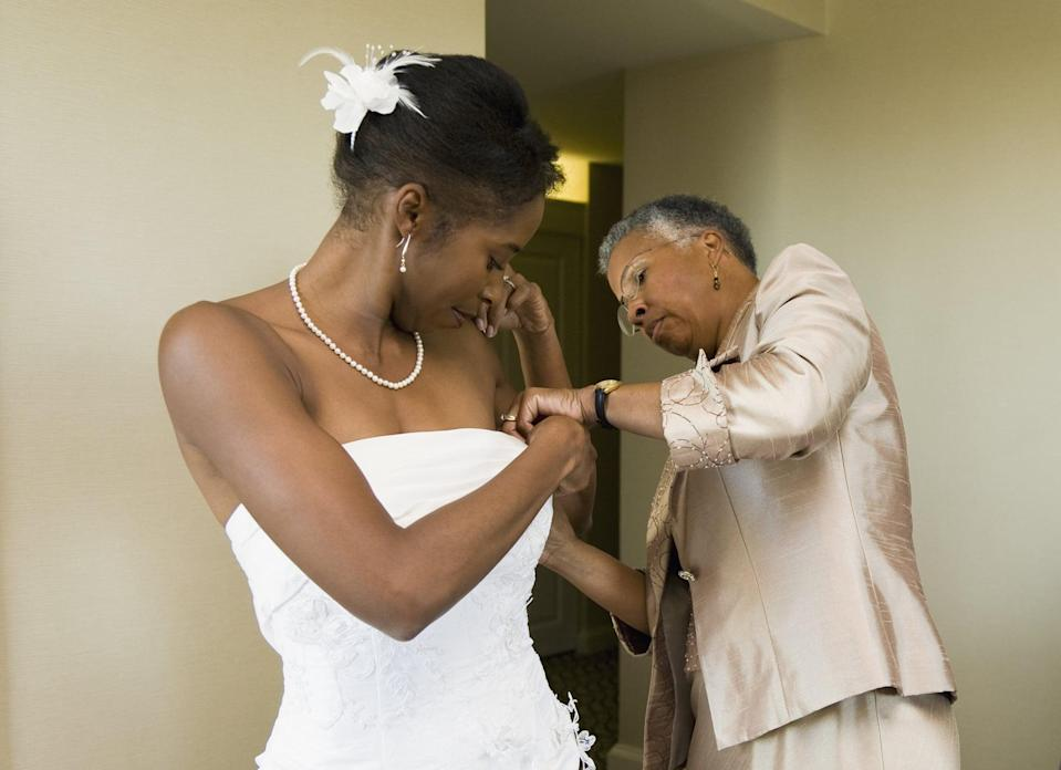 <p>Emotions come straight through a photo if you can get one of your mother or a close friend helping you into your dress.</p>