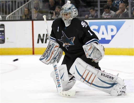 San Jose Sharks goalie Thomas Greiss (1), of Germany, blocks a shot by the Dallas Stars during the second period of an NHL hockey game in San Jose, Calif., Thursday, Feb. 2, 2012. (AP Photo/Tony Avelar)