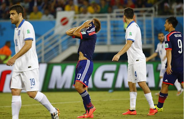 Japan's Yoshito Okubo (2nd L) reacts after missing a chance to score a goal during their 2014 World Cup Group C soccer match against Greece at the Dunas arena in Natal June 19, 2014. REUTERS/Kai Pfaffenbach (BRAZIL - Tags: SOCCER SPORT WORLD CUP)
