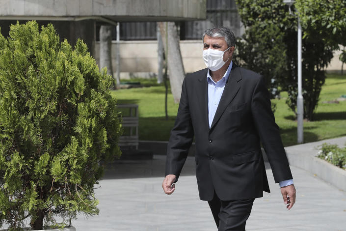 In this photo released by the official website of the office of the Iranian Presidency, then Minister of Road and Urbanization Mohammad Eslami, walks in the presidency compound, April 7, 2021, in Tehran, Iran. On Sunday Aug. 29, 2021, Iranian President Ebrahim Raisi appointed Eslami as the new director of the country's nuclear department, replacing Ali Akbar Salehi, a U.S.-educated prominent nuclear scientist. (Iranian Presidency Office via AP)