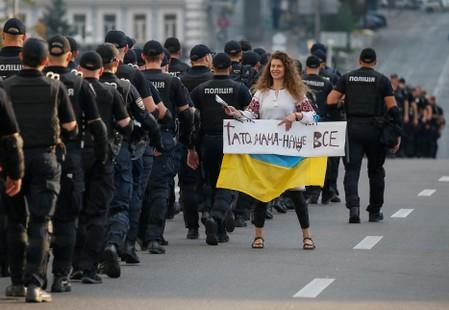 An anti-LGBT protester is seen before an equality March, organized by the LGBT community in Kiev