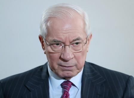Former Ukrainian Prime Minister Mykola Azarov attends an interview with Reuters in Moscow
