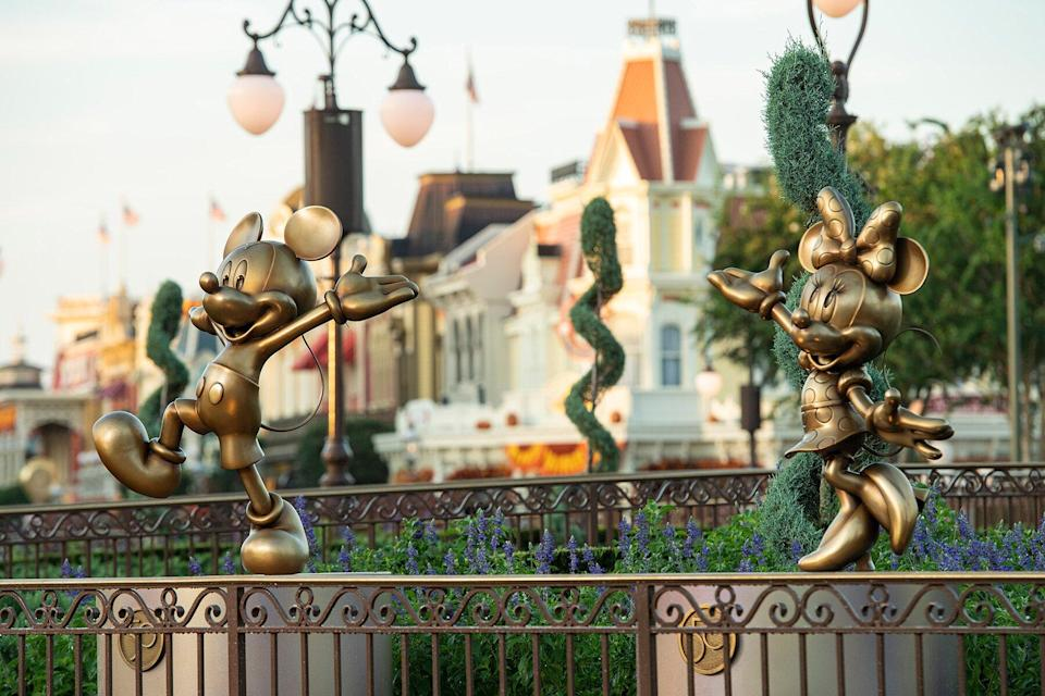 """Mickey Mouse and Minnie Mouse """"Disney Fab 50"""" golden character sculptures"""
