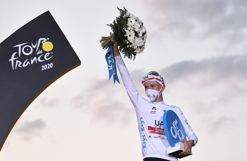 Team UAE Emirates rider Slovenias Tadej Pogacar celebrates on the podium after winning the white jersey of best young of the 107th edition of the Tour de France cycling race after the 21st and last stage of 122 km between ManteslaJolie and Champs Elysees Paris on September 20 2020 Photo by AnneChristine POUJOULAT AFP Photo by ANNECHRISTINE POUJOULATAFP via Getty Images