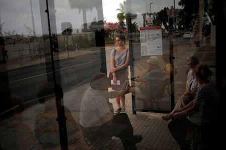 People wait at a bus stop during the EU referendum in the British overseas territory of Gibraltar, historically claimed by Spain, June 23, 2016. REUTERS/Jon Nazca