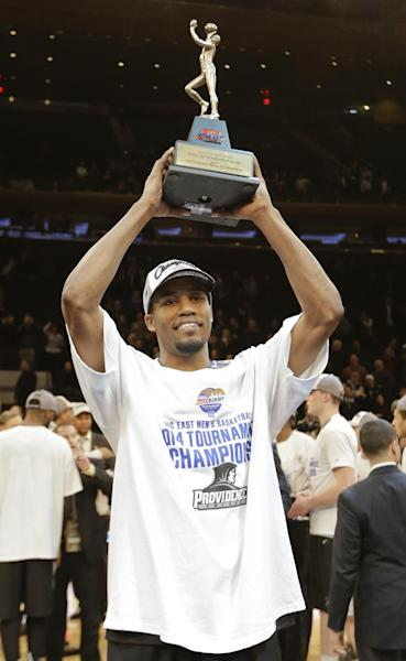 Providence's Bryce Cotton holds the Most Outstanding Player trophy after an NCAA college basketball game against Creighton in the finals of the Big East Conference tournament Saturday, March 15, 2014, at Madison Square Garden in New York. Providence won the game 65-58. (AP Photo/Frank Franklin II)