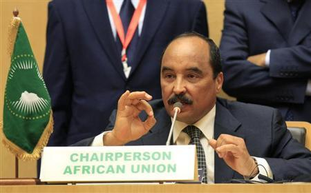 Mauritania's President and African Union chairman Mohamed Ould Abdel Aziz addresses a news conference during the closing ceremony of the 22nd Ordinary Session of the African Union summit in Addis Ababa