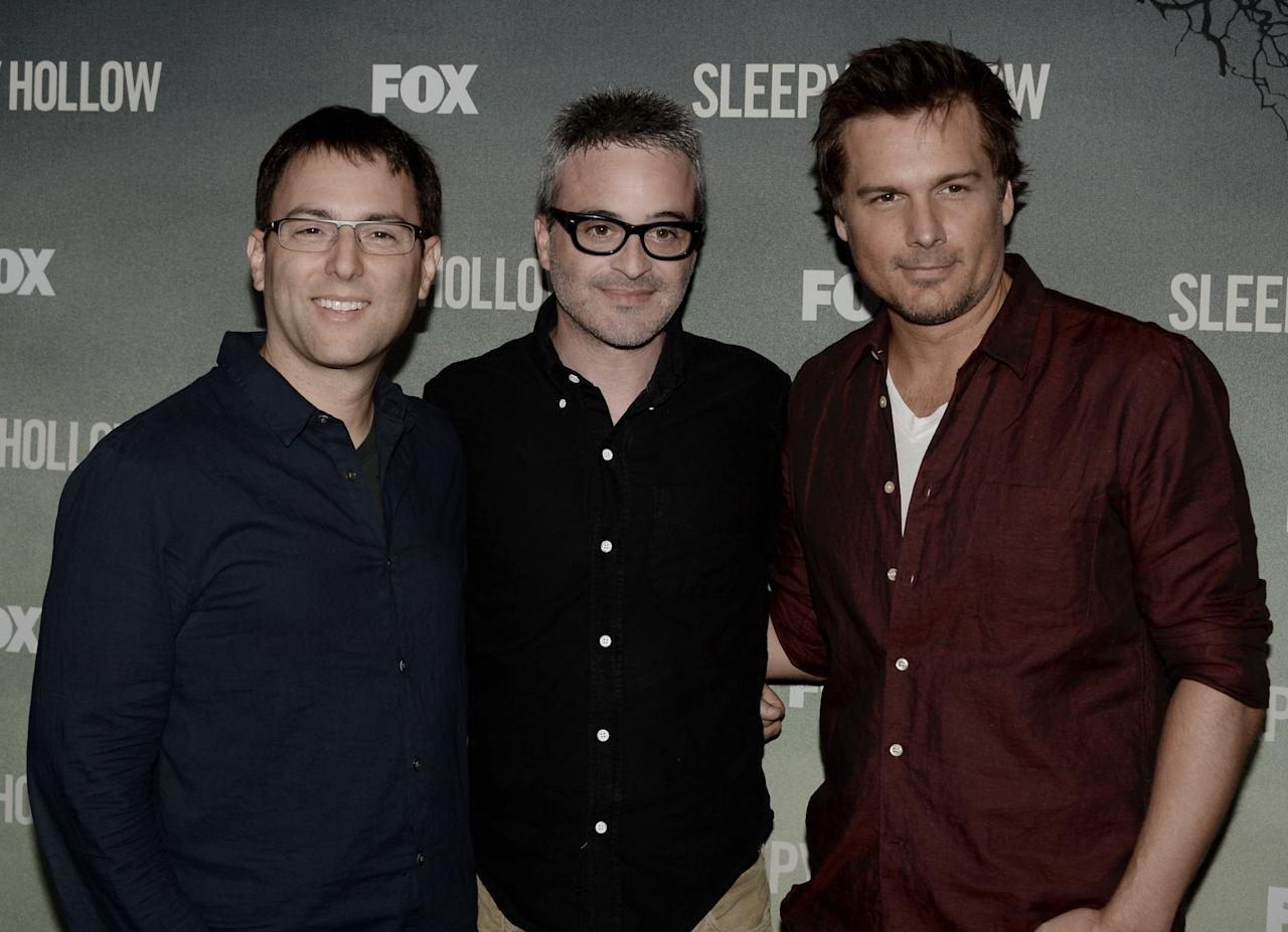 "LOS ANGELES, CA - SEPTEMBER 08: (L-R) Executive producers Mark Goffman, Alex Kurtzman and Len Wiseman arrive at a special screening of 20th Century Fox Television's ""Sleepy Hollow"" at the Hollywood Forever Cemetery on September 8, 2013 in Los Angeles, California. (Photo by Kevin Winter/Getty Images)"