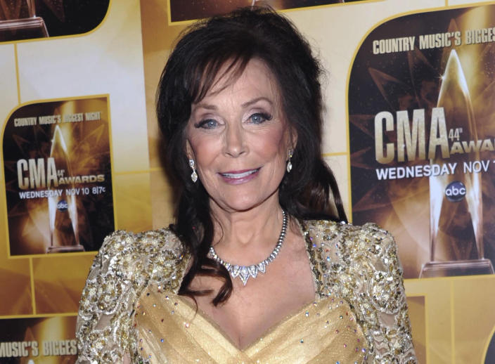 """FILE - In this Nov. 10, 2010 file photo, singer Loretta Lynn poses in the press room during the 44th Annual Country Music Awards in Nashville, Tenn. Newly discovered documents indicate country music legend Loretta Lynn is three years older than she has led people to believe, a change that undermines the story told in """"Coal Miner's Daughter."""" (AP Photo/Evan Agostini, File)"""