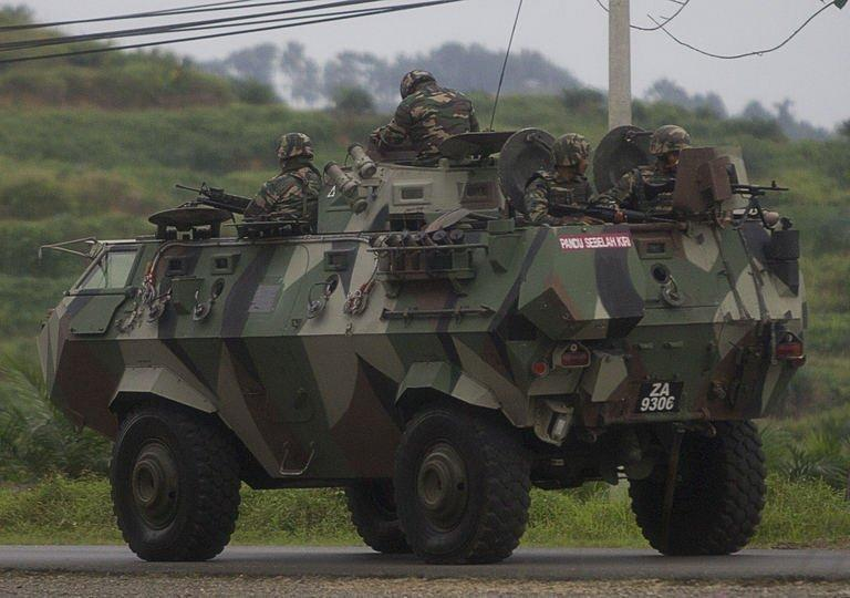 Malaysian soldiers drive towards the area where the stand-off with Sulu gunmen is on going, in Tanduo village on March 4, 2013. Malaysian air and ground forces launched an assault on defiant Filipino intruders on Tuesday as the government moved to end a three-week incursion that had already killed 27 people
