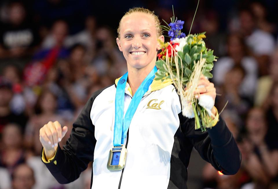 OMAHA, NE - JUNE 26: Dana Vollmer celebrates after she received her gold medal for finishing first in the championship final heat of the Women's 100 m Butterfly during Day Two of the 2012 U.S. Olympic Swimming Team Trials at CenturyLink Center on June 26, 2012 in Omaha, Nebraska. (Photo by Jamie Squire/Getty Images)