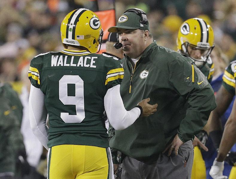 Green Bay Packers head coach Mike McCarthy talks to quarterback Seneca Wallace during the second half of an NFL football game against the Chicago Bears Monday, Nov. 4, 2013, in Green Bay, Wis. The Bears won 27-20. (AP Photo/Mike Roemer)