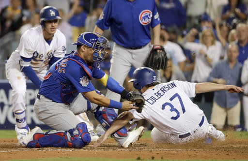 The Dodgers' Charlie Culberson (37) is called safe at home past Cubs catcher Willson Contreras during the seventh inning of Game 1 of the National League Championship Series. (AP)