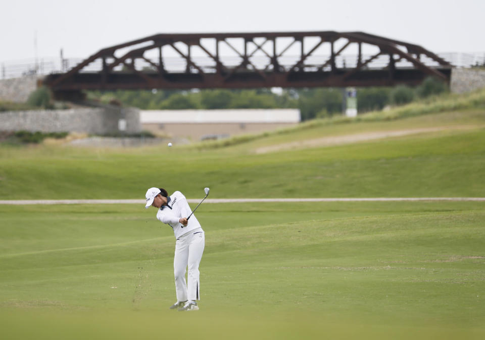 Jin Young Ko, of South Korea, plays her third shot in the second fairway during the final round of the LPGA Volunteers of America Classic golf tournament in The Colony, Texas, Sunday, July 4, 2021. (AP Photo/Ray Carlin)