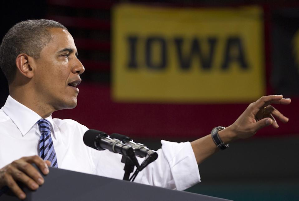 FILE - In this April 25, 2012 file photo, President Barack Obama speaks at the University of Iowa, in Iowa City, Iowa. The president is heading to the political battleground state of Iowa this week to prod Congress to act on his agenda. The president will visit TPI Composites, a wind manufacturer in Newton, on Thursday to highlight his push for tax credits to encourage investments in clean energy technologies. (AP Photo/Carolyn Kaster, File)