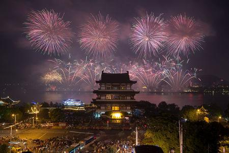 Fireworks explode over Juzi Island to mark the 90th anniversary of the founding of the China's People's Liberation Army in Changsha, Hunan province, China August 1, 2017. REUTERS/Stringer