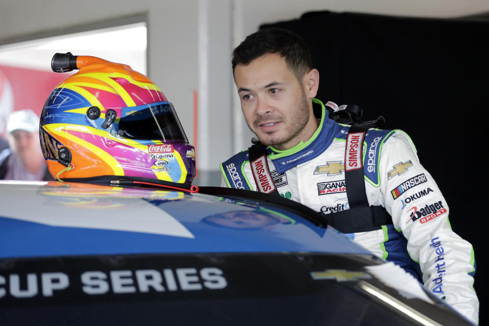 Kyle Larson climbs in his car as he gets ready for a NASCAR auto race practice at Daytona International Speedway, Saturday, Feb. 8, 2020, in Daytona Beach, Fla. (AP Photo/Terry Renna)