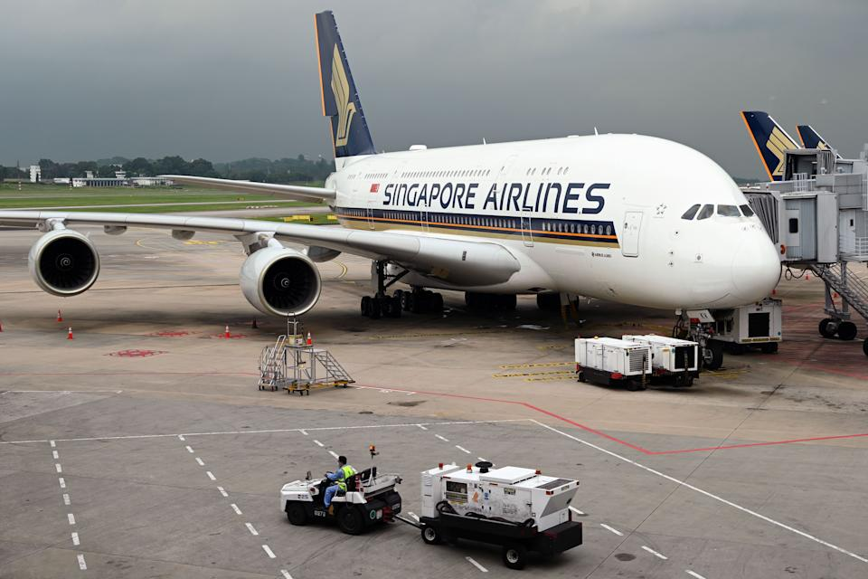 Singapore Airlines Ltd.'s website was temporarily down over the weekend and travel agencies are seeing a surge in demand for flights. (PHOTO: ROSLAN RAHMAN/AFP via Getty Images)