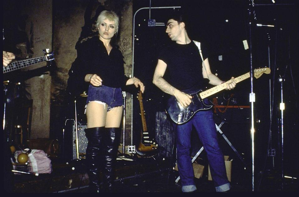 <p>Blondie's Debbie Harry makes jean shorts look very downtown chic. The singer styled her cut-offs with an usual choice of footwear, thigh high leather boots. </p>