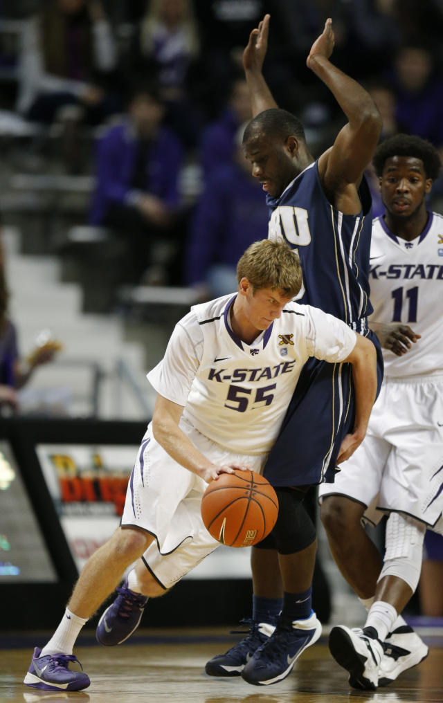 Kansas State guard Will Spradling (55) works around Oral Roberts guard Obi Emegano during the first half of an NCAA college basketball game in Manhattan, Kan., Wednesday, Nov. 13, 2013. (AP Photo/Orlin Wagner)