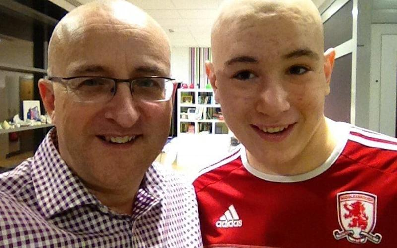 Nigel Maguire (left) with his son Lewis whom he believes contracted cancer from artificial pitch rubber pellets - Cascade News