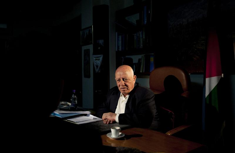 """Former Palestinian Prime Minister Ahmed Qureia speaks during an interview with the Associated Press in his office in Abu Dis, near Jerusalem, Monday, April 23, 2012. With gloom deepening over the prospects for peace, Qureia a leading Palestinian figure is suggesting the Palestinians might drop the """"two-state solution"""" that underpinned two decades of wrangling _ and instead seek to replace Israel with a multi-ethnic state covering all of historic Palestine. (AP Photo/Sebastian Scheiner)"""