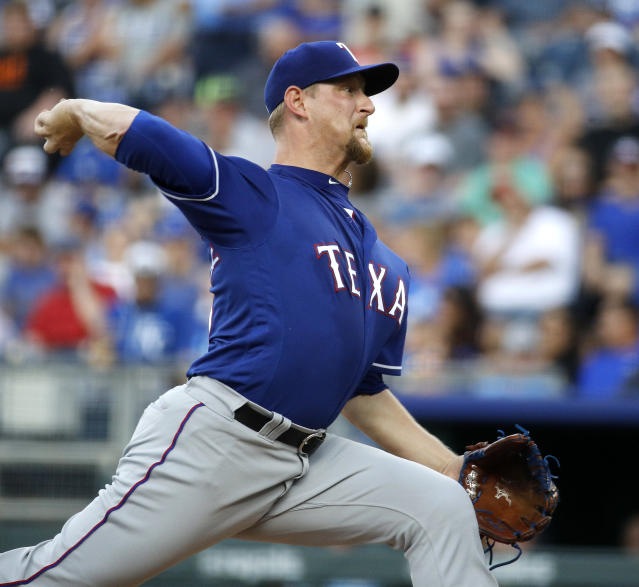 Texas Rangers starting pitcher Austin Bibens-Dirkx throws during the first inning of the team's baseball game against the Kansas City Royals on Wednesday, June 20, 2018, in Kansas City, Mo. (AP Photo/Charlie Riedel)