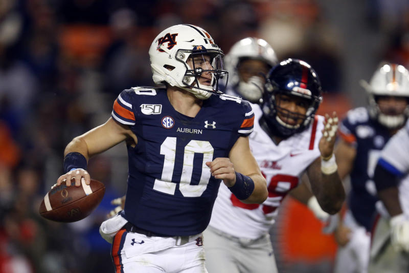 Auburn and Bo Nix are still in the mix for a New Year's Six bowl berth. (AP Photo/Butch Dill)