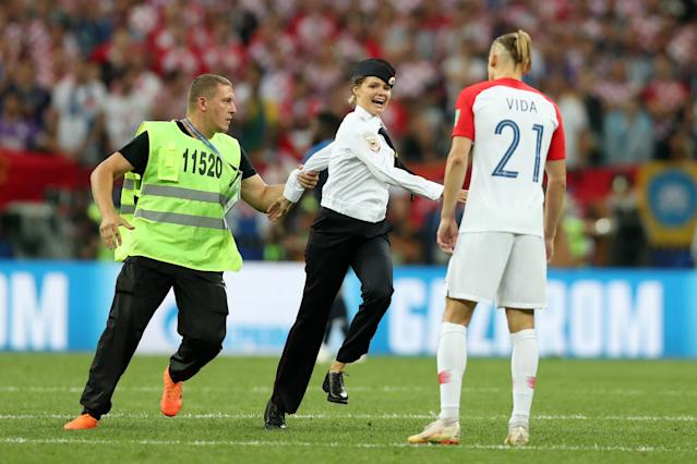 The four protesters who invaded the field during the World Cup final on Sunday between France and Croatia in Moscow have been sentenced to 15 days in jail. (Getty Images)