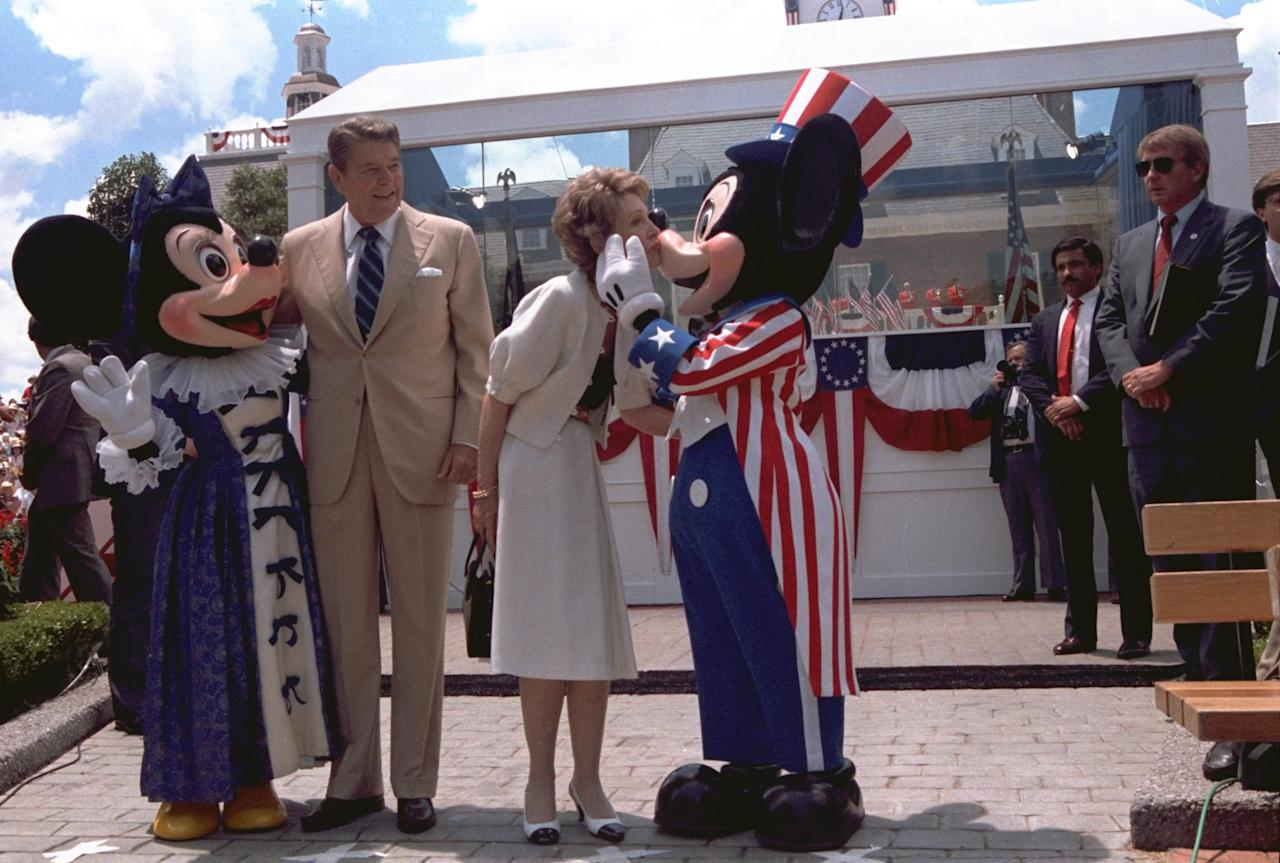<p>President Reagan and Mrs. Nancy Reagan are shown embracing Minnie Mouse and Mickey Mouse at the Epcot Center in Walt Disney World, in Orlando, Florida, on May 27, 1985. (AP Photo/Scott Stewart) </p>