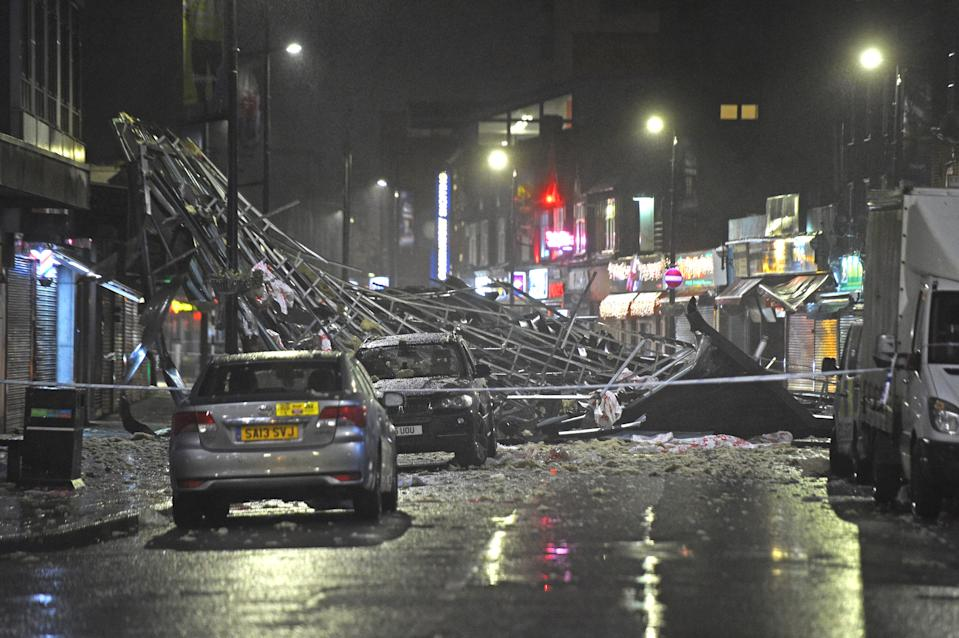 Slough high street after a roof was blown off a building onto the road amid strong winds which have battered parts of the UK.