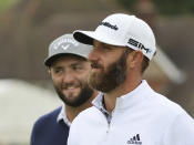 United States' Dustin Johnson, right walks with Spain's Jon Rahm on the 1st fairway during a practice round for the British Open Golf Championship at Royal St George's golf course Sandwich, England, Wednesday, July 14, 2021. The Open starts Thursday, July, 15. (AP Photo/Ian Walton)