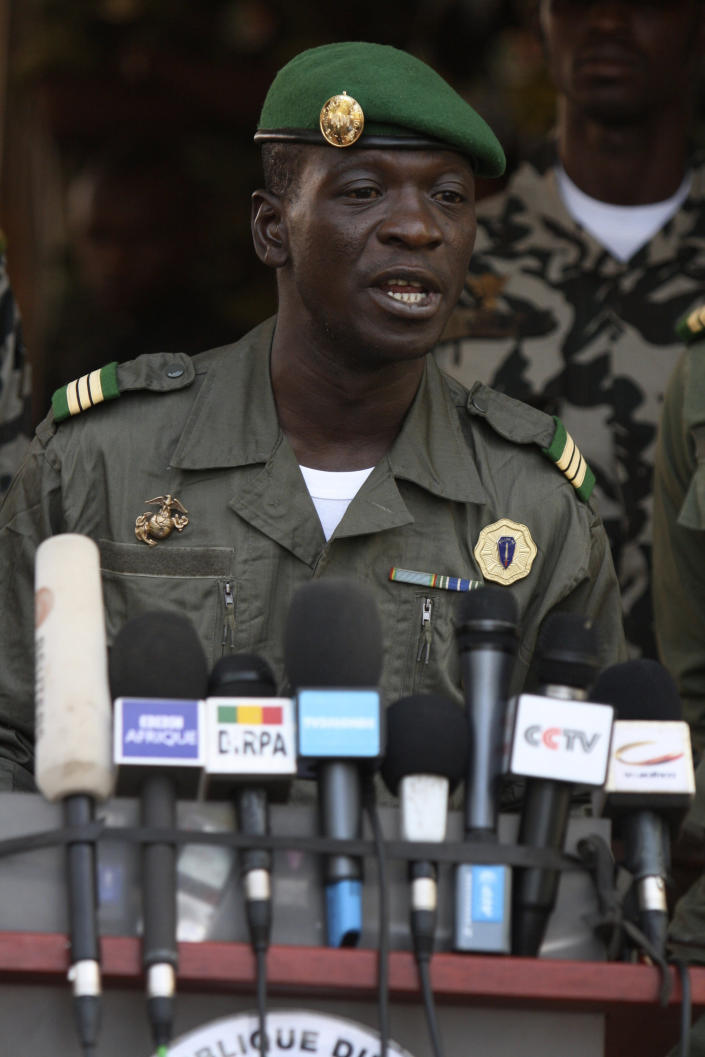 Coup leader Capt. Amadou Haya Sanogo speaks to the press at junta headquarters in Kati, outskirt of Bamako, Mali Tuesday, April 3, 2012. The day after an embargo was placed on Mali, the soldier who led a recent coup said Tuesday that he agrees with restoring constitutional order, but first Mali's ills need to be addressed by holding a national convention which will decide on the best way forward. With Capt. Sanogo refusing to step down, surrounding nations have imposed severe financial sanctions on Mali. (AP Photo/Harouna Traore)