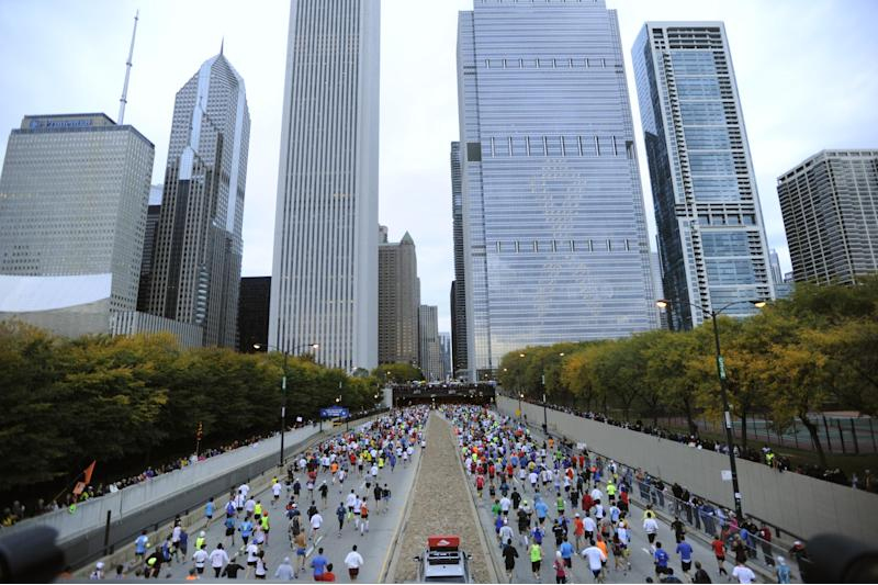 FILE - In this Oct. 7, 2012 file photo, runners start the 2012 Chicago Marathon. Police have not stated the security measures they are taking for the Sunday Oct. 13, 2013, Chicago Marathon, The marathon is the first World Marathon Major in the United States since the Boston Marathon bombings last April will be the most closely watched. (AP Photo/Paul Beaty, File)