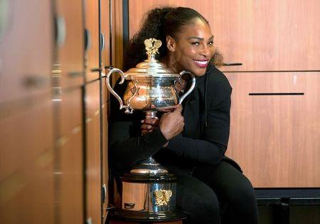 Serena Williams of the U.S. holds the trophy after winning the Women's singles final against sister Venus at the Australian Open tennis tournament in Melbourne, Australia
