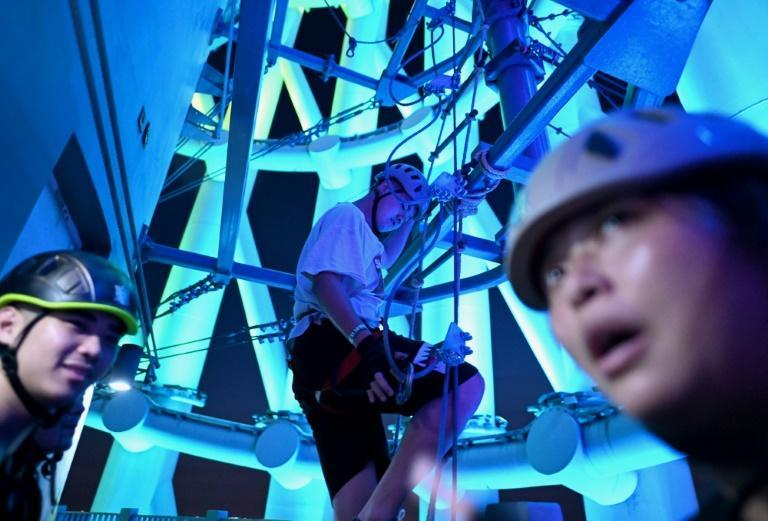 Wearing a helmet and a harness, tourists can scramble and climb between the distinctive twisting metal structure