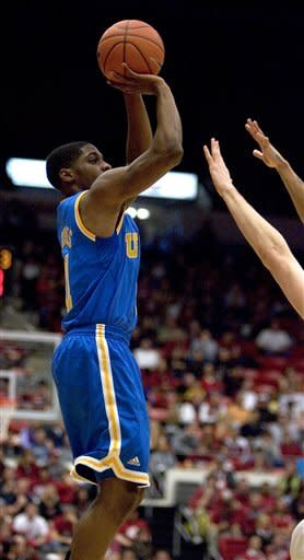 UCLA guard Lazeric Jones (11) shoots over a Washington State defender during the first half of an NCAA college basketball game on Saturday, Feb. 4, 2012, in Pullman, Wash. (AP Photo/Dean Hare)