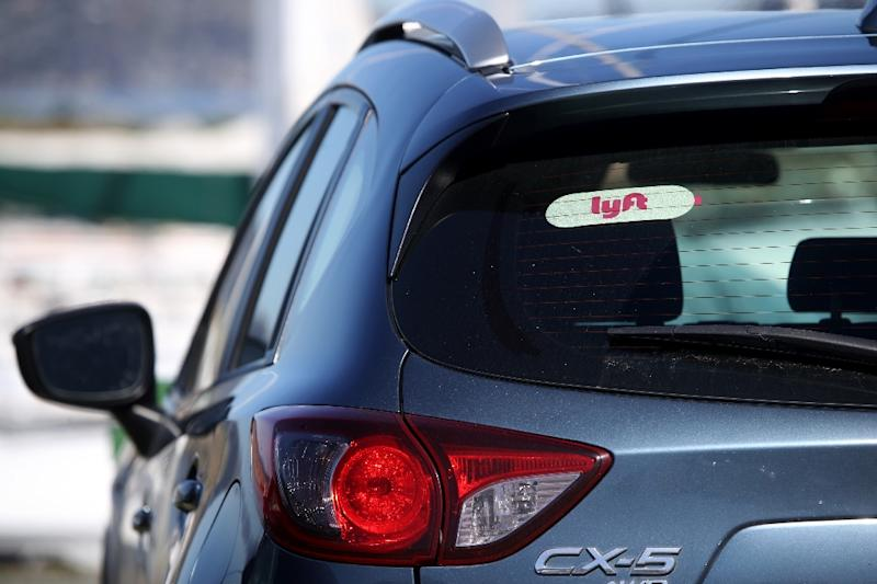 Lyft has posted heavy losses but sees a future where people move away from private vehicles (AFP Photo/JUSTIN SULLIVAN)