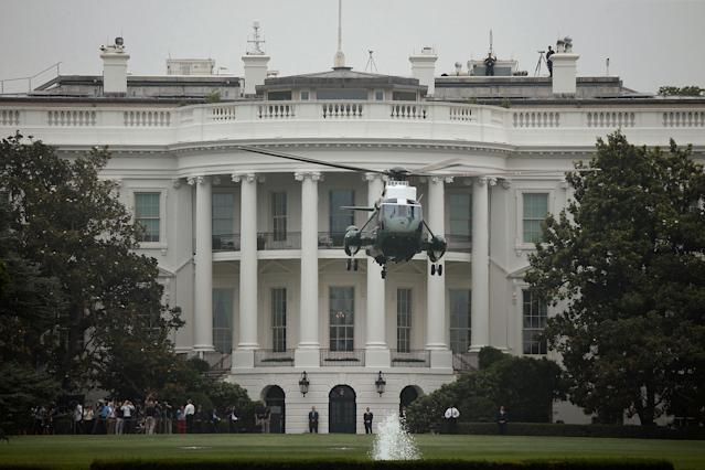 <p>Marine One carrying President Donald Trump departs from the South Lawn of the White House in Washington, July 5, 2017. (Photo: Joshua Roberts/Reuters) </p>
